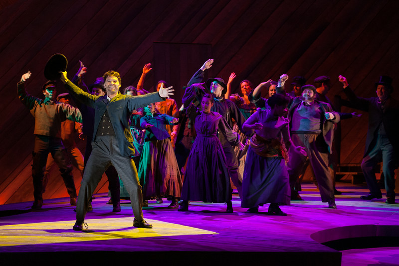 "Ryan McKinny as Billy Bigelow and the ensemble in The Glimmerglass Festival's 2014 production of Rodgers and Hammerstein's ""Carousel."" (Karli Cadel/The Glimmerglass Festival)"