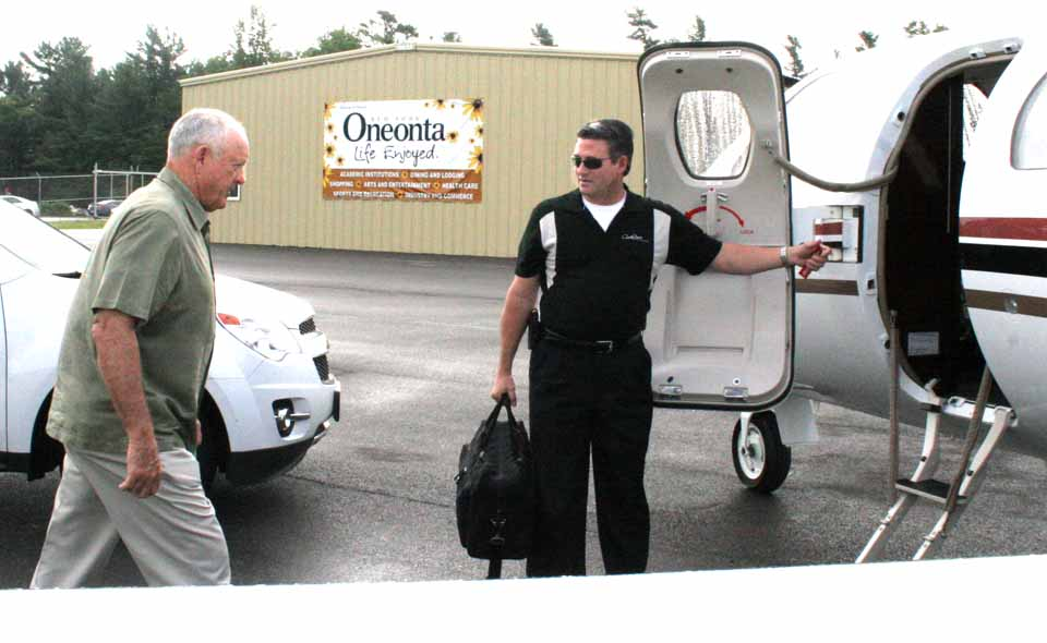 "Passing the banner, ""Oneonta, Life Enjoyed,"" Former MLB pitcher Nolan Ryan departs from Oneonta Municipal Airport Monday after a weekend in Cooperstown for the Hall of Fame's 75th anniversary Induction Weekend."