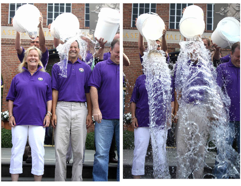 """A few minutes ago, Hall of Fame Chairman Jane Forbes Clark and Hall President Jeff Idelson joined all Hall employees on duty today in accepting the ALS """"Ice Bucket"""" Challenge from the NFL Hall of Fame and getting doused with ice water.  Miss Clark passed on the challenge – to Bassett Hospital.  The nationwide campaign had raised $93 million to combat ALS, also known as Lou Gehrig's Disease.  Before the dousing, the Hall chair made note of Gehrig, and also Catfish Hunter, who is also suffering from the disease.  (Jim Kevlin/AllOTSEGO.com)"""