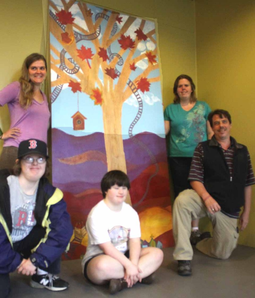 Artists from Arc Otsego's Main View Gallery installed a mural on the lower level of the walkway to the parking deck in downtown Oneonta today.  Clockwise from upper left are Karin Bremer, Linda McCord, Katie Sullivan Vincent Devine and Maria Brockmann.  (Jim Kevlin(AllOTSEGO.com)