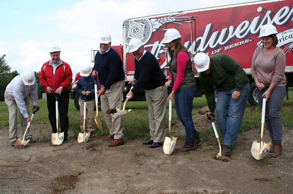 A ceremonial ground breaking this afternoon started work on the new 82,000-square-foot building that will house a new Cooperstown Brewing Co. plant and Northern Eagle Beverage warehouse on Browne Street in West Oneonta.  From left are Bryan Birdsall, sales manager; George Allen, president; Whit Hager, 9, son of principal Lou Hager III; Matt Curley, general manager; Alicia Hager and her brother, Lou III, and Melissa Miosek, sales.  (Jim Kevlin/AllOTSEGO.com)