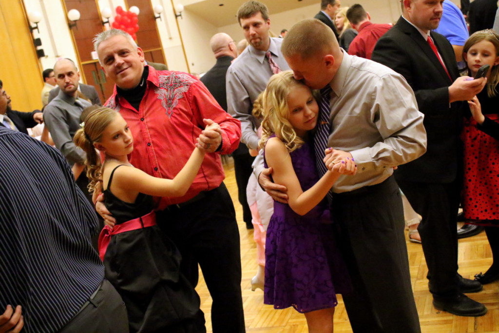 Shane Couse and daughter Shayanna, left, Oneonta, and Ron Coe with daughter Veronica, Oneonta, right, slow dance at the YMCA's annual Father Daughter Dance this evening, held at SUNY Oneonta's Hunt Union Ballroom. (Ian Austin/AllOTSEGO.com)