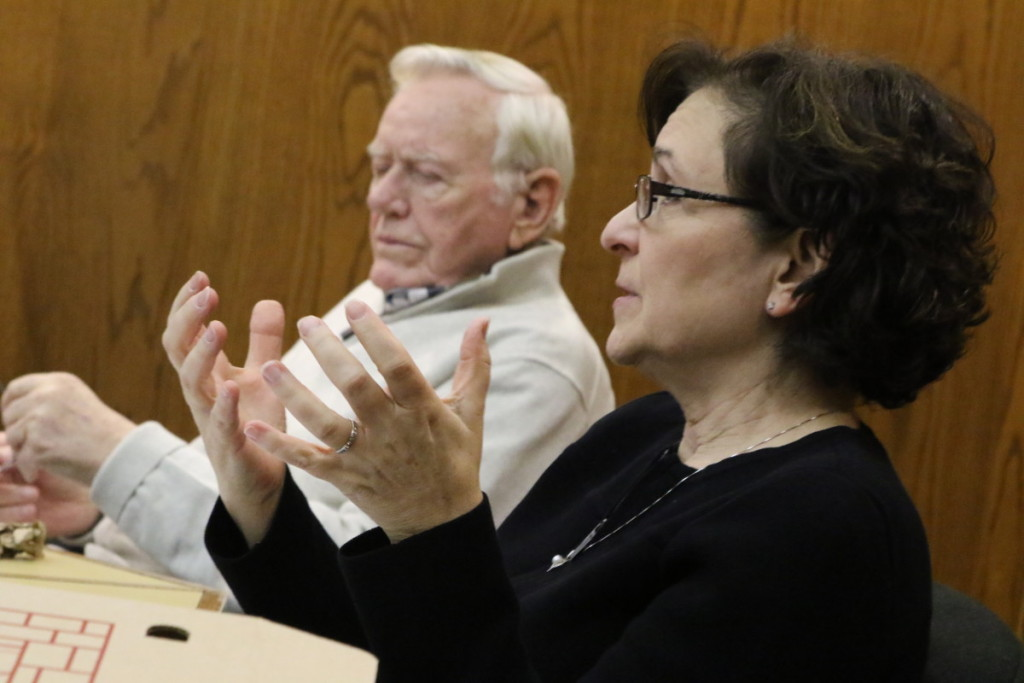 Council Member Melissa Nicosia, Second Ward, explains why she believes the qualifications for the City Manager should be removed from the charter. Former mayor David Brenner listens. (Ian Austin/AlOTSEGO.com)