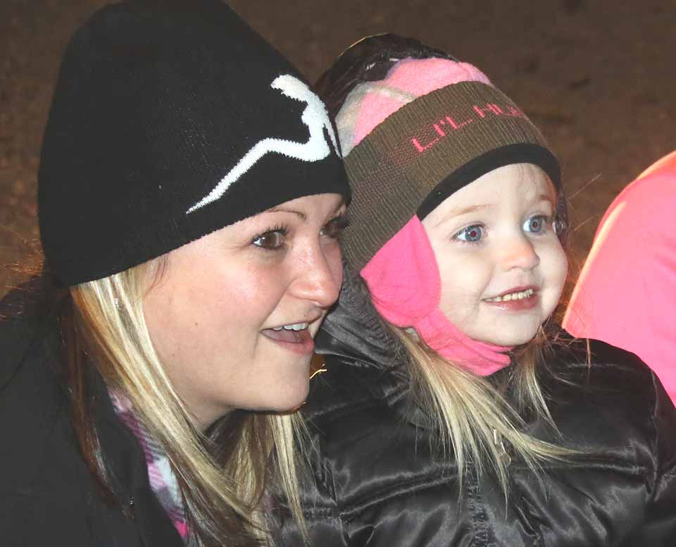 The first blast of fireworks also lit up the faces of little Jaylynn Banner and her mom, Kayla, from Hartwick, who were watching from Lakefront Park.