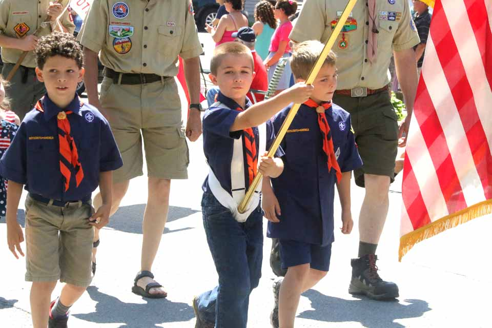 Cub Scout Shamus Murphy carries the flag for his den's honor guard, flanked by Owen Flannigan and Foster Waite. (Jim Kevlin/AllOTSEGO.com)