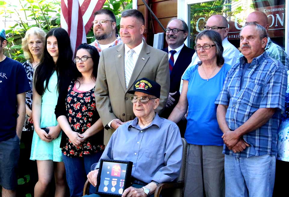 U.S. Rep. Chris Gibson, R-19, poses with World War II veteran Donald Diamond, Central Bridge, a few moments after presenting him with a boxed set of all the medals the sailor earned during his service, which included the D-Day invasion. Diamond, now 90, enlisted when he was 17, and participated in the Normandy invasion when he was 18. Diamond, a coxswain, never spoke of his war experiences until approached by a reporter at a parade in Schoharie County following Hurricane Irene. His niece, Kathy Fallon, contacted the congressman's office, who was able to obtained a European Theater Medal, two stars; an American Theatre Medal, a Asiatic-Pacific Medal, one star, and a Victory Medal for his constituent. One of Diamond's son traveled from Washington State for today's ceremony, held in Gibson's Cooperstown office. (Jim Kevlin/AllOTSEGO.com)