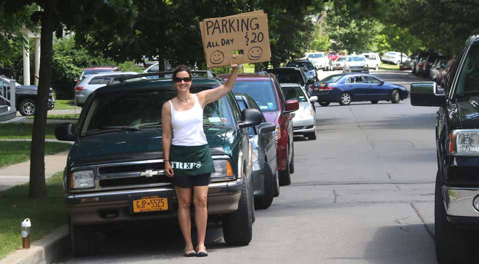 Carina Franck, on upper Main Street, was among the many Cooperstownians offering parking to arriving baseball fans.  (Jim Kevlin/AllOTSEGOc.com)