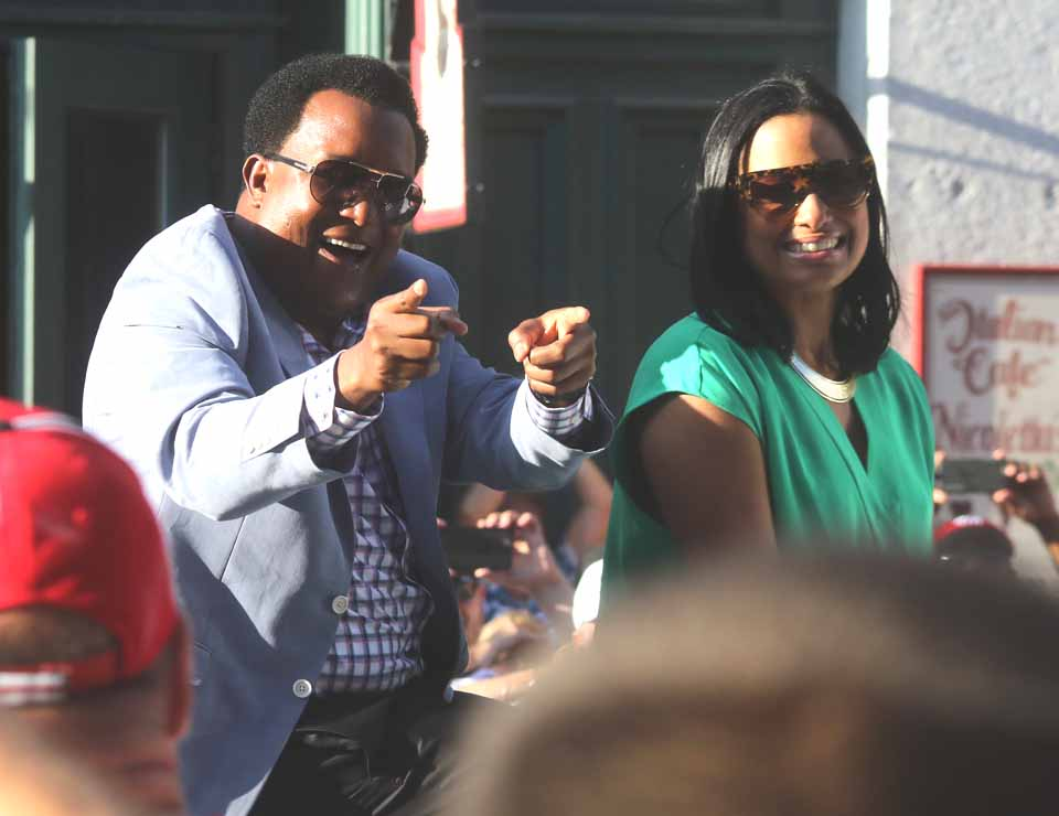 Former Seattle Mariner Ken Griffey Jr. and wife Melissa respond to fans who cheered the couple on Main Street, Cooperstown, durng the Parade of Legends that ended a few minutes ago.