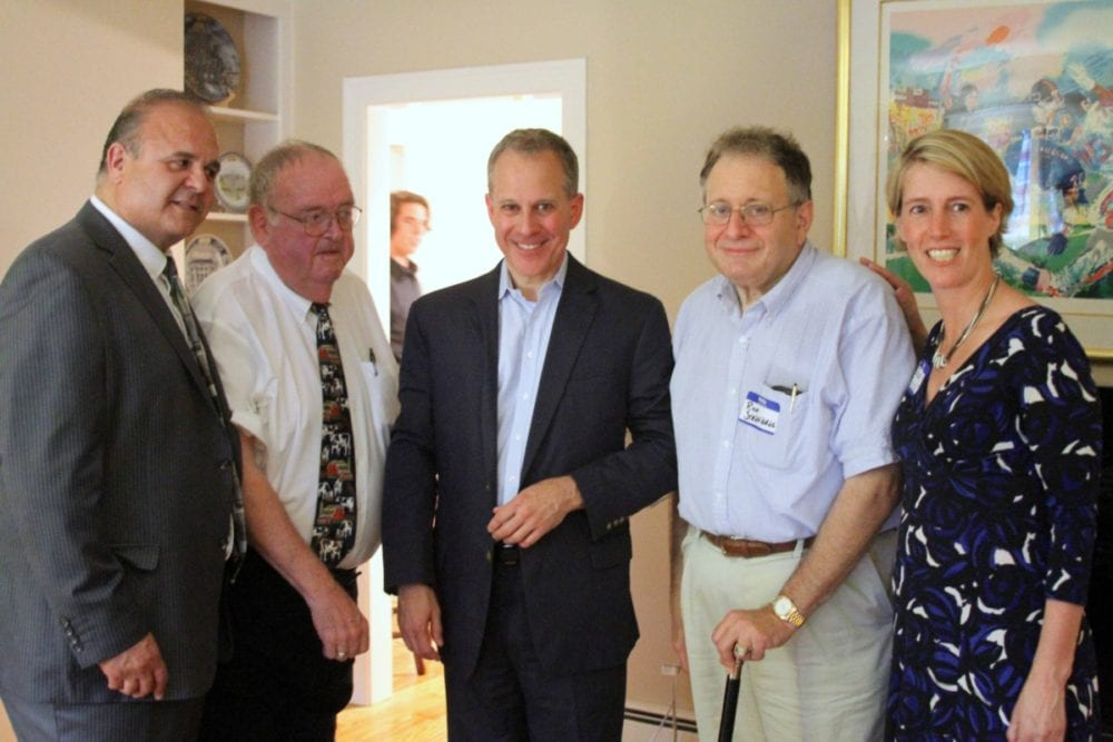 """State Attorney General Eric Schneiderman is in the Cooperstown area this weekend, posing here last evening at the annual county Democratic Dinner at Village Trustee Richard Sternberg's Westridge Road home. From left are county Chairman Richard Abbate, Assemblyman Bill Magee, D-Nelson, Schneiderman, Dr. Sternberg and Zephyr Teachout, Democratic candidate for the 19th Congressional District. This afternoon at 4, Schneiderman will appear at a Glimmerglass Festival forum, discusses the current applications of """"The Crucible."""" The operatic adaption of Arthur Miller's play is part of the festival's 2016 season."""