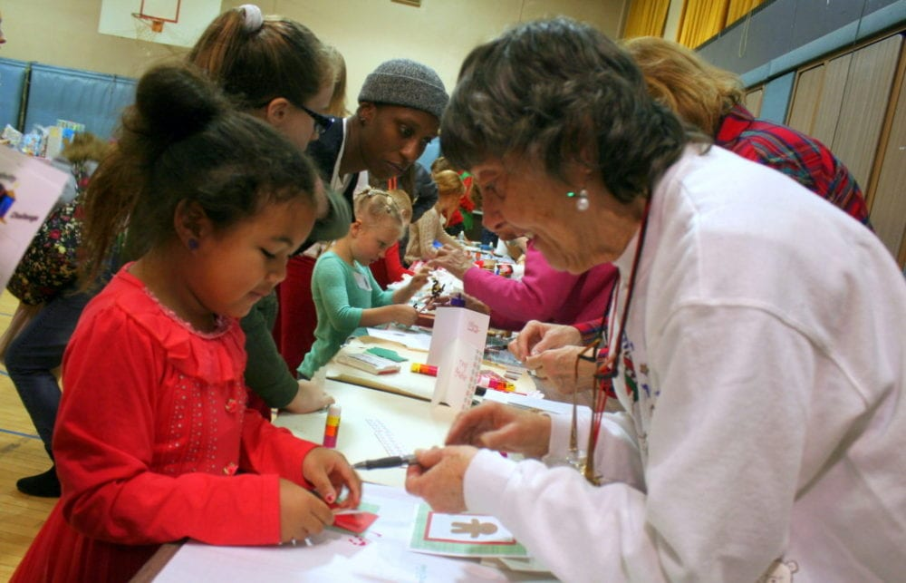 Jaden Lee, Oneonta, gets help with making a Christmas card from Pat Murphy, Oneonta, at the 2nd annual Angel Tree Party at St. Mary's this afternoon. The event, hosted by Jail Ministries of Otsego County, provided an afternoon of activities and food for children which included card making, face painting, cookie decorating, making center pieces and other Holiday crafts. There was even a shop where kids could pick out gifts free of charge to send to their incarcerated parents. At the end of the party, each child goes home with several wrapped presents for themselves to open on Christmas day. (Ian Austin/AllOTSEGO.com)