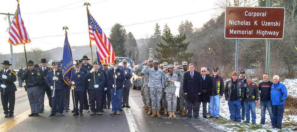"""Honor guards, state legislators, family and friends gathered on Route 357 in northern Delaware County this morning to dedicate the """"Corporal Nikolas Uzenski Memorial Highway."""" (Jeff Bishop photo)"""